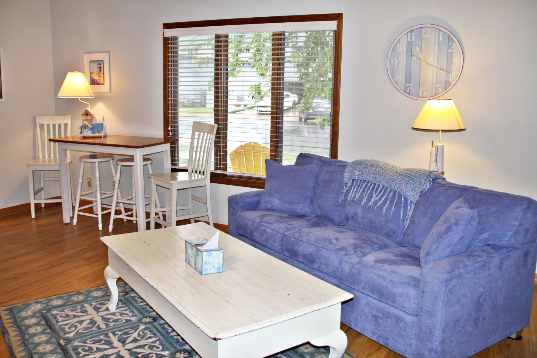 Bright living room with plenty of seating at Driftwood